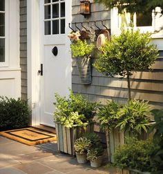 I like the idea of hooks outside the door.  This is such a pretty back door.