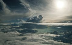 Nehmzow strapped himself into an airplane, put on an oxygen mask and shot these photos. Incredible.