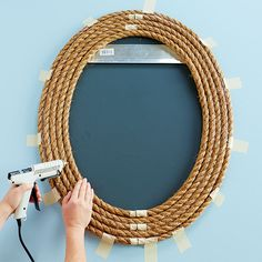 Mirror Frame,Glue five loops of rope to form the frame Bathroom Mirror Frame Learning how exactly to frame a bathroom mirror can allow you to create a custom mirro. Rope Frame, Rope Mirror, Oval Mirror, Mirror Glue, Bathroom Mirror Makeover, Deco Marine, Custom Mirrors, Deco Originale