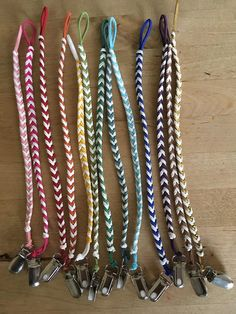 Braided faux leather pacifier clips
