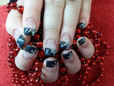 Black glitter tips with snowflake christmas nail art Taken at:10/12/2013 13:40:32 Uploaded at:12/12/2013 19:02:45 Technician:Elaine Moore
