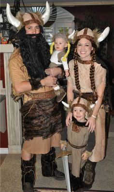 Viking Costumes for me AND Jacob- gauntlets, horned helmet, brown lace up boots, green flowy skirt, gold eye shadow with heavy brown liner
