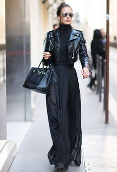 Alessandra Ambrosio wearing a black leather jacket, with a turtleneck and maxi skirt