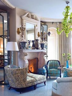 Beautiful blue and white sitting room,  fireside.  Barry Dixon of HGTV
