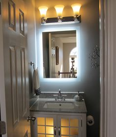 Photo Gallery For Website Our MAM Side Lighted Mirror wide x tall shown with overhead Vanity MirrorsBathroom