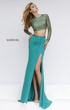 Totally on trend this two piece Sherri Hill will be easy to dance dance in with a thigh high slit
