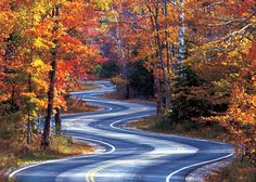 For a breathtaking drive, roll along scenic Highway 42 in Wisconsin's Door County this fall. Your reward at the tip of the peninsula, just past Gills Rock, is a winding stretch of road encapsulated by a sunburst of fall color.