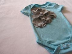 grey flower cluster baby one piece. Use felt or old t-shirt and layer circles.