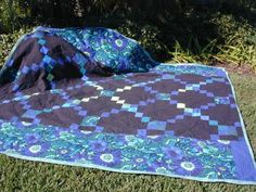 "Hello, I made a quilt for my son from a picture of an antique quilt, so I had to no pattern to follow. Unfortunately, I didn't ""measure"" the central portion of the quilt before I called it done and started putting borders on it. After the first round of borders was on, I discovered that th..."