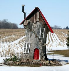 Gnome house - love this !    The best use of a cut down tree Ive seen.. Just outside of Princeton, Ontario...
