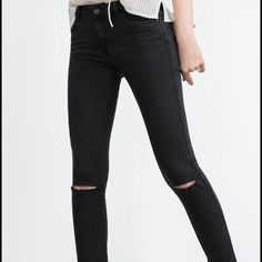Black Knee-Ripped Skinny Jeans Condition: very good....Mid Rise Skinny jeans.       Only worn twice. Zara Jeans Skinny
