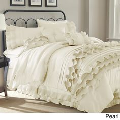Add a gracefully feminine touch to your bedroom with this ruffled comforter set from Anastacia. Available in platinum and pearl white, this neutral eight-piece comforter set melds well with traditiona