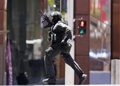 A gunman was holding an undisclosed number of hostages Monday morning inside a chocolate shop in Sydney, Australia, police said Monday afternoon. They said t. Port Arthur Massacre, Australian Special Forces, London Clubs, Police Officer, Hold On, Leather Pants, Military, Shopping, Chocolate Shop
