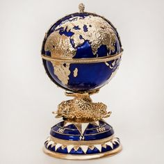 Feel the whole world underneath your fingertips!..  This globe-shaped box contains a surprise and a secret false floor.  Created in the timeless style of the Russian Jewelry school of Karl Fabergé, the box will serve as the perfect decoration on your work desk, fireplace mantle, or library shelf.  Bring a small part of Russian history into your home with this original souvenir from Russia!