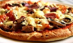 Groupon - Pizza Lunch or $ 12 for $20 Worth of Italian Cuisine for Dinner at Music City Pizza in Nashville. Groupon deal price: $9