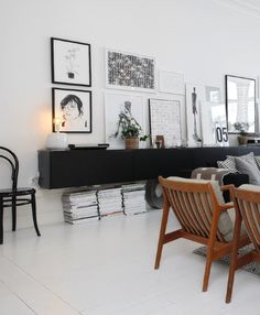 gorgeous living room. Love the black with the wood, white and neutrals