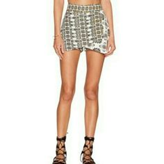 Free People Loose Weave Tribal Skort Tribal prints and contrast embroidery accent a breezy Free People skort with crossover front panel Banded waist over flapping front panel Asymmetrical hem, Hidden Side zip Cotton, machine wash The tan-ish parts are embroired along the waist and the asymmetrical hem. Free People Shorts Skorts
