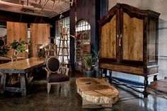 The Pierre Cronje showroom in Wynberg, Cape Town - Wolfe st, Chelsea Village. (A Gable top Cape Armoire stands over a coffee table made from a large Yellowwood trunk, an Ovalback armchair, and a Hampton dining table) Log Furniture, Fine Furniture, Furniture Ideas, Logs, Cape Town, The Hamptons, Showroom, Man Cave, Woodworking Projects