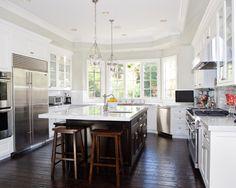 white cabinets dark island dark floors