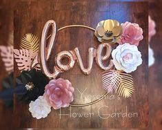 paper flowers in hula hoop with love mylar balloon.