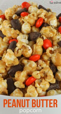 Peanut Butter Popcorn - sweet and salty popcorn covered in peanut butter and chock full of Peanut Butter M&M's. A delicious Peanut Butter dessert that is super easy to make!  It would be a great Halloween Treat or a Fall movie night dessert! Pin this delicious popcorn recipe for later and follow us for more great Thanksgiving Food Ideas. #PeanutButter #PeanutButterDessert #Popcorn #PopcornRecipes #SweetPopcorn #FallDesserts #ThanksgivingTreats
