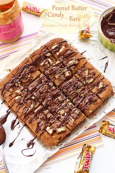Peanut Butter Candy Bars – crumbly, melt in your mouth peanut butter bars packed with chopped Reese's peanut butter cups and topped with more candy pieces.