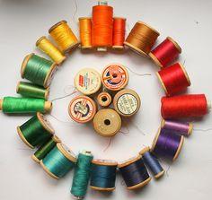 coloured spools of thread