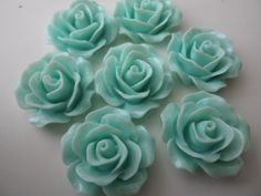 8 PIECES Resin flower cabochons. $3.85, via Etsy.