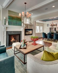 Like that the T.V isn't over the fireplace.  Art combo in these open spaces is interesting. House of Turquoise: Great Neighborhood Homes