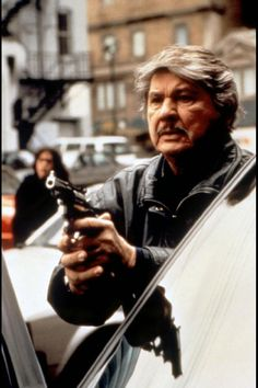 Charles Bronson RIP 1921-2003 Famous for the death wish films, magnificent seven, etc. Was considered to play Snake Plissken in escape from New York and John McClane in die hard. Would have been great in an expendables movie if he was still alive.