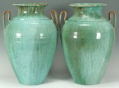 """Large Pr. of Chinese Glaze NC Pottery Urns : Large pair of teal Chinese glaze Seagrove pottery urns, attributed to Waymon H. Cole (Montgomery County, NC 1905 - 1987). 21 1/4"""" H. Second quarter of 20th Century. Note: for a similar example, see """"North Carolina Pottery"""" edited by Barbara Stone Perry and published by the University of North Carolina Press 2004"""