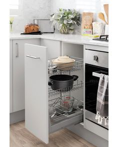 Make your small space work hard! Our pullout baskets are the perfect storage solution for narrow cabinets in hard to reach spaces - functional and stylish! Available via click and collect, pick up or home delivery . Kitchen Interior, New Kitchen, Kitchen Design, Kitchen Ideas, Narrow Cabinet, White Round Tables, Kitchen Cupboard Doors, Scandinavian Living