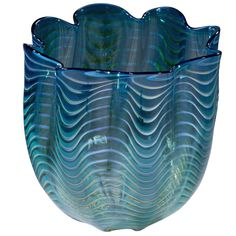 "Dale Chihuly blown glass dark green, teal blue, yellow, white and black ribbed Persian basket for Portland Press in 1998, signed PP 98, 7 1/2 D, 7 /34"" H."