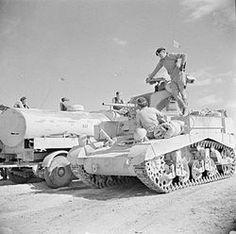 A Stuart tank being refuelled from an RAF fuel bowser outside Sidi Barrani, 15 November 1942.
