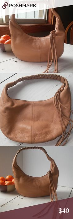 "Banana Republic mini hobo bag This glorious purse is in unbelievable condition!! Super soft buttery leather in a beautiful camel color. It's bohemian style with fun leather tassels and a leather braided handle. If I didn't have 5 million purses, I'd keep it!!!! It's 71/2"" x 12"". Enjoy fantasizing that it's on your shoulder! Banana Republic Bags Hobos"