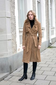 Carolina Engman // suede trench coat, black turtleneck, black jeans and ankle boots.