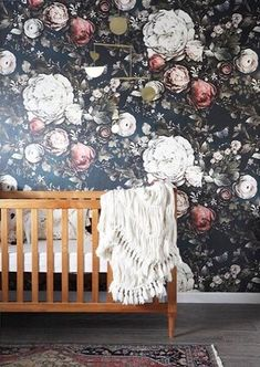 Mara's moody floral nursery reveal Wall of dark wallpaper for office/front room