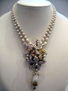 Vintage Miriam Haskell - love the mixture of beaded and vintage components hung from two pearl strands