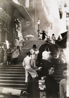Vendors and pedestrians on a staircase in Hong Kong, November 1934