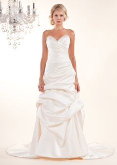 (Choice 2) 8366- Vinette- Strapless A-line gown with ruched bodice, asymmetrical bustled skirt and Swarovski beading along bust-line and hem.