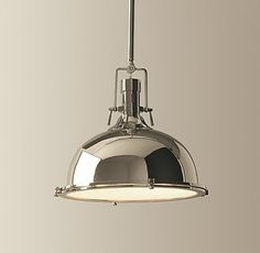 "Restoration Hardware   The shape feels industrial, while the polished exterior looks sharp and modern.     Comes in three sizes: 11"" (11"" diam., 8""H; 22-3/4""H; one 60W max. bulb); 15"" (15"" diam., 12-1/4""H; 19-1/2""–55-1/2""H; one 150W max. bulb); and 19"" (19"" diam., 14""H; 27-1/2""–63-1/2""H; two 100W max. bulbs)"