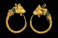 A PAIR OF GREEK GOLD BULL HEAD EARRINGS HELLENISTIC PERIOD, CIRCA 2ND CENTURY B.C.