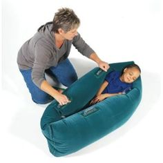 Pea pod  for deep calming pressure. We had a couple of these in the life skills room I worked in, PDX, and they were a hit! Poppable though :)
