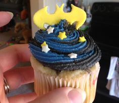 Batman cupcakes. Swirled blue and black buttercream then cut the batman logo from fondant. My son loved them and they were so easy.