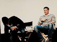 Jared and Jensen highfiving with their feet. ;-)