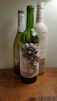 Rustic bottles set of Decorated with twine, burlap, lace, and flowers. Recycled Wine Bottles, Wine Bottle Corks, Glass Bottle Crafts, Painted Wine Bottles, Diy Bottle, Bottles And Jars, Paint Bottles, Bottle Vase, Wrapped Wine Bottles