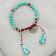 Mahlia Collection's Silk Road -  the Jungsi bracelet features turquoise and dyed red horn beads