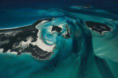 Islet and sea bed, Exuma Cays, Bahamas. Source: YannArthusBertrand.org