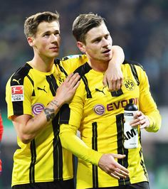 Erik Durm and  Lukasz Piszczek of Dortmund celebrate at the end of the Bundesliga match between Werder Bremen and Borussia Dortmund at Weserstadion on January 21, 2017 in Bremen, Germany.