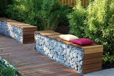 Contemporary garden seating made out of gabions- the wood softens the industrial feel a bit Garden Seating, Outdoor Seating, Outside Seating, Outdoor Spaces, Bamboo Hedge, Gabion Wall, Gabion Fence, Garden Structures, Garden Spaces